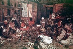 Brazilian slaves processing manioc into flour