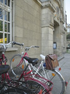 The bicycle and bag of Lucy Barnhouse, on a picturesque street in Mainz, Germany