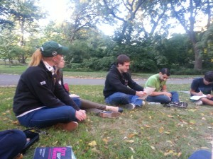 The class discusses the legacy of J. Marion Sims near the site of his memorial in Central Park.