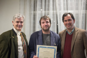 Dr. David Myers (left) and Dr. Nicholas Paul (right) present Tobias Hrynick (center) with the 2015-6 Loomie Prize.