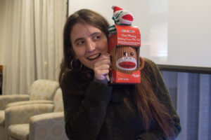 Giulia Crisanti poses with her white elephant gift: a brown monkey mug.